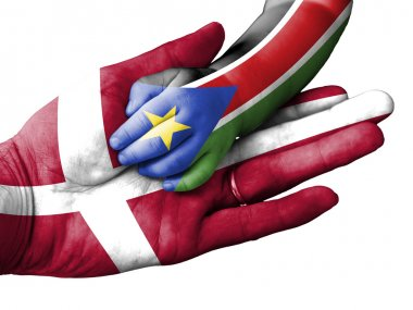 Adult man holding a baby hand with Denmark and South Sudan flags overlaid. Isolated on white