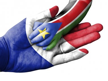 Adult man holding a baby hand with France and South Sudan flags overlaid. Isolated on white