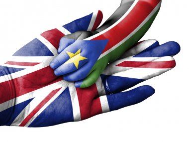 Adult man holding a baby hand with United Kingdom and South Sudan flags overlaid. Isolated on white
