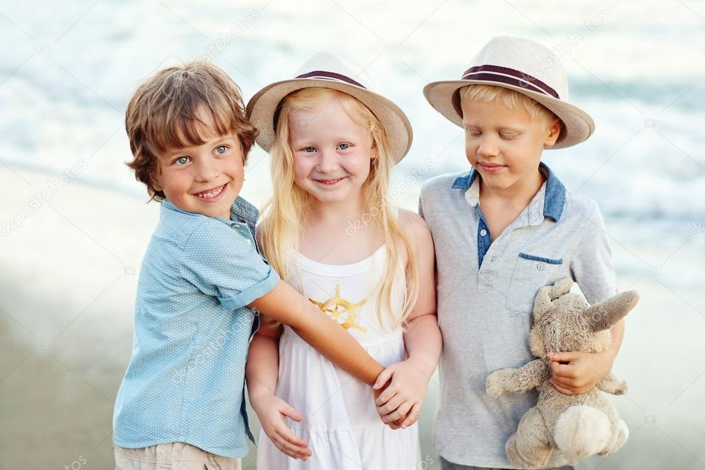 Funny Kids On The Beach Stock Photo
