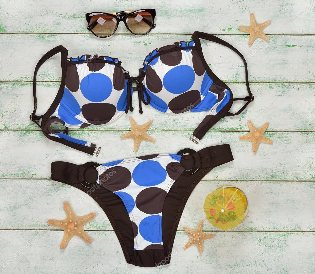 Costume da bagno e stelle marine — Foto Stock © Olyina #112704162