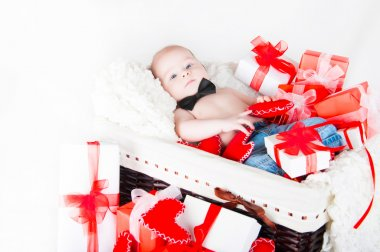 Gift basket with gift boxes, hearts and Cupid. Valentines Day