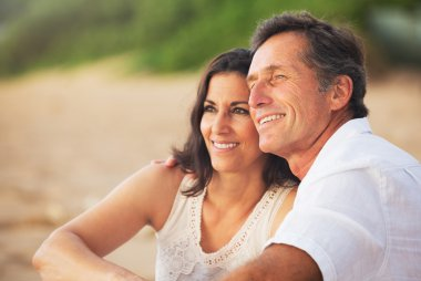 Happy Romantic Mature Couple Enjoying Sunset on the Beach stock vector