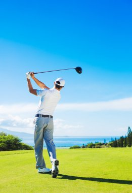 Man Playing Golf, Hitting Ball from the Tee