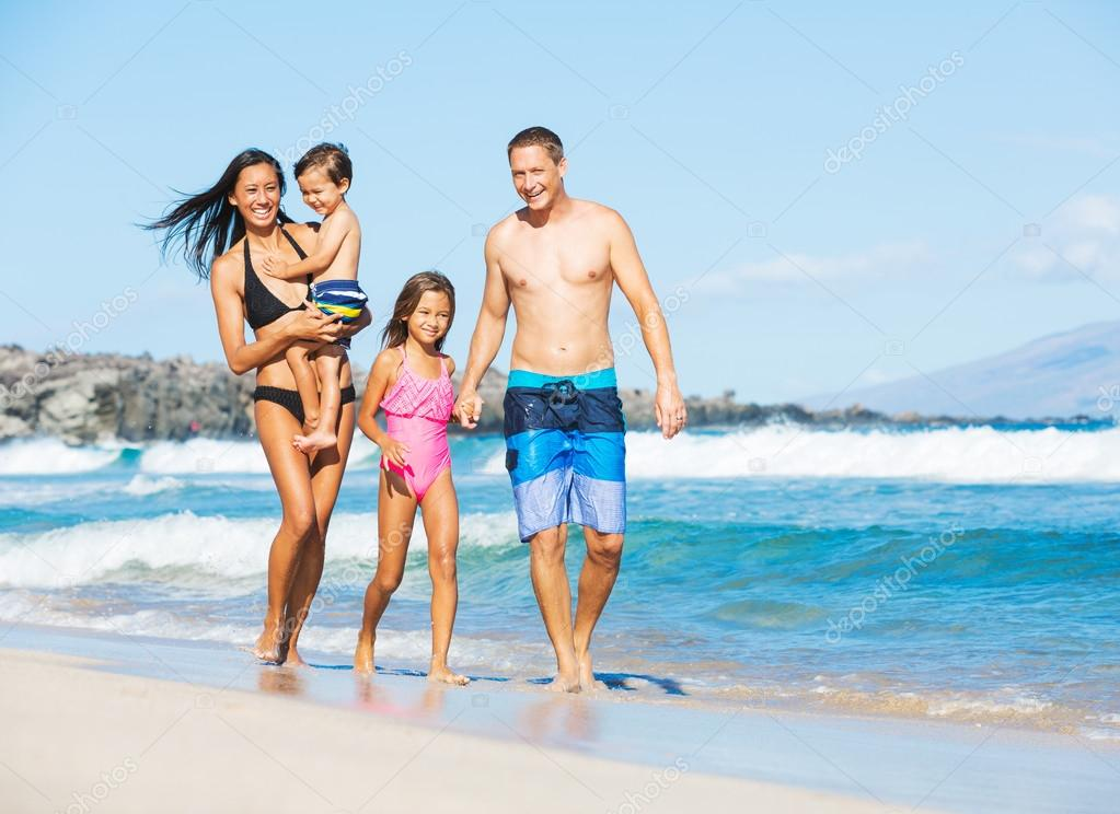 Happy Mixed Race Family on the Beach