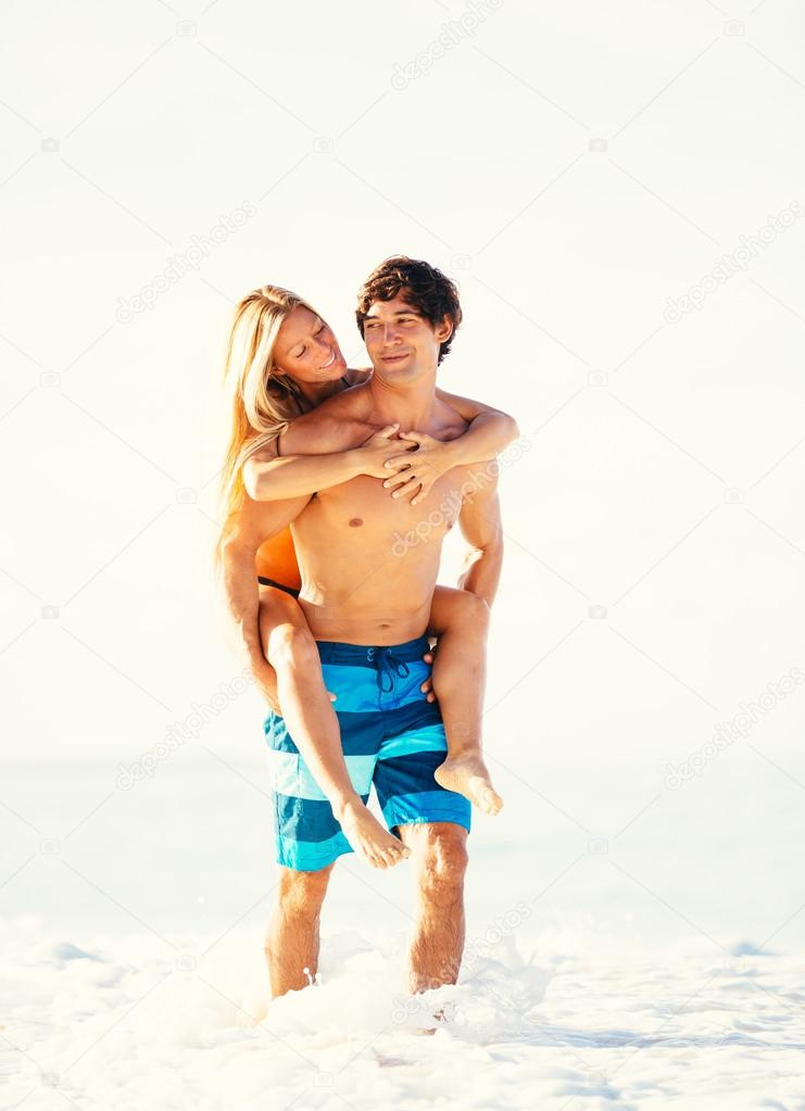 Attractive Couple Walking on Tropical Beach