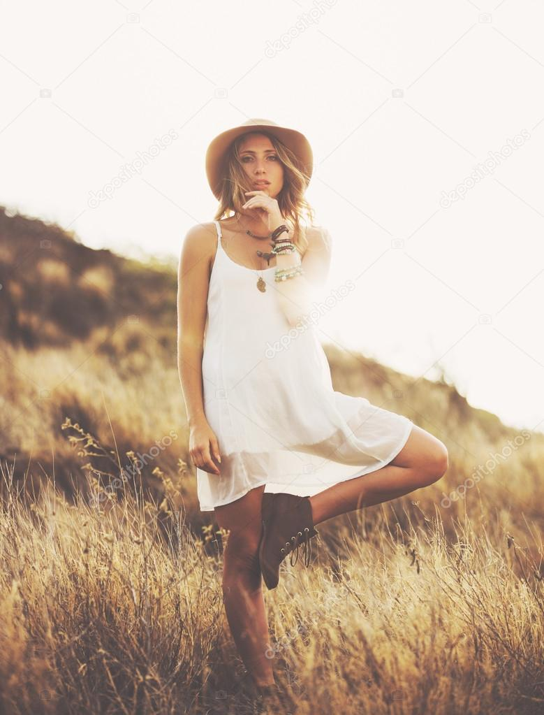 Fashion Portrait of Beautiful Young Woman Backlit at Sunset