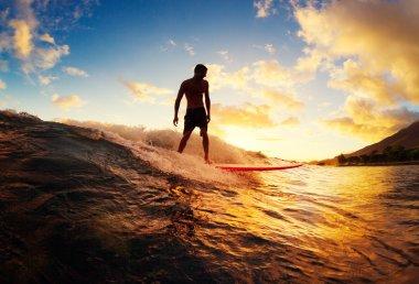 man Surfing at Sunset