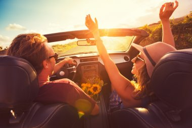 Happy Young Couple Driving Along Country Road in Convertable at Sunset. Freedom Adevnture Roadtrip! stock vector