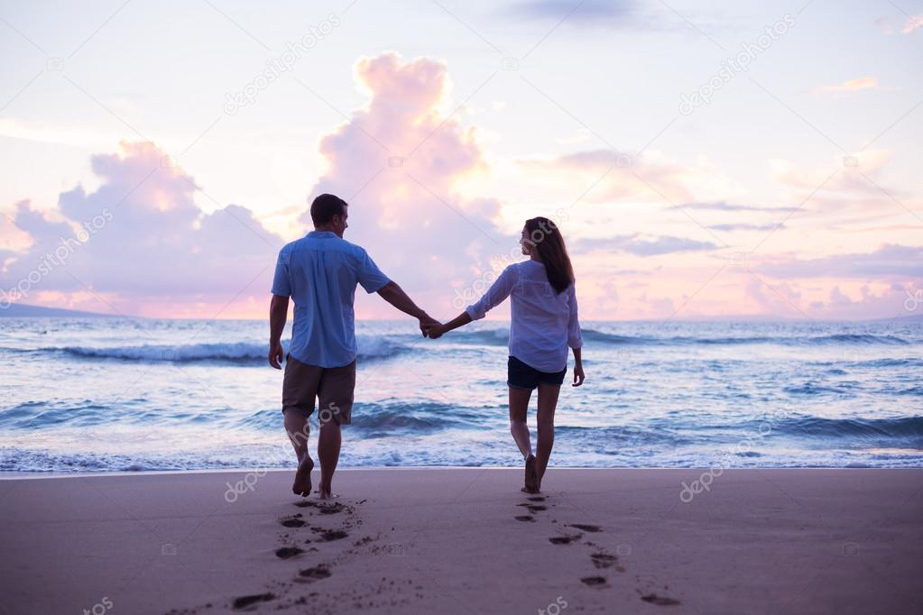 Lovers Walking on the Beach at Sunset