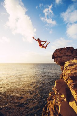 Cliff Jumping extreme at sunset