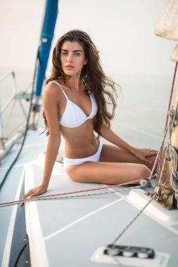 Girl sits on the yacht