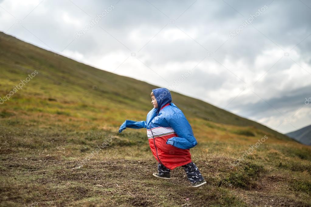 Boy walks on mountain
