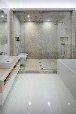 Bathroom in a modern loft style. Sink, toilet, bidet, shower.