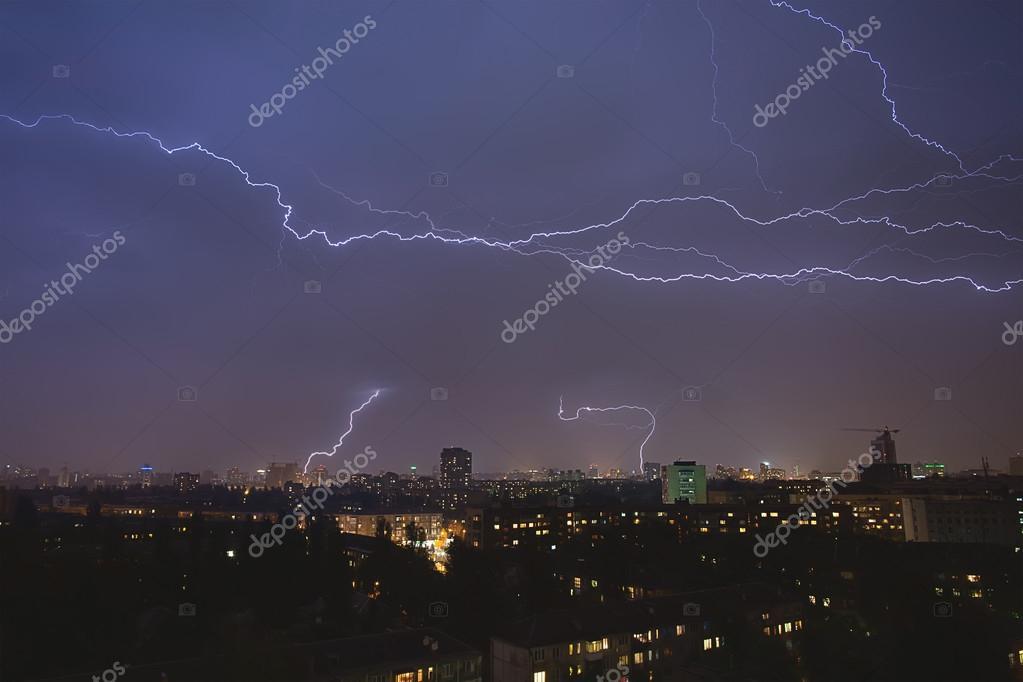 lightning strikes over night town during a thunderstorm. Kiev, U