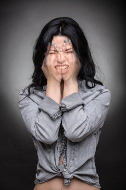 Multi exposure portrait of emotional brunette.