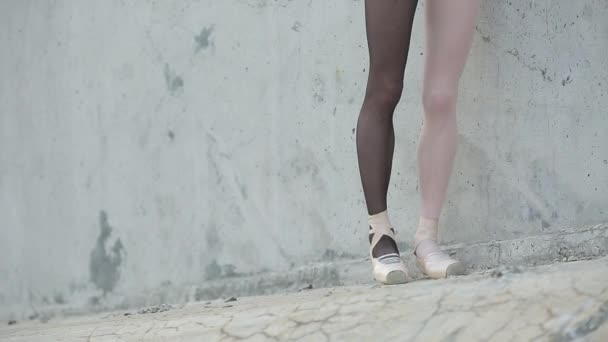Video footage of the young graceful ballerina feet close-up