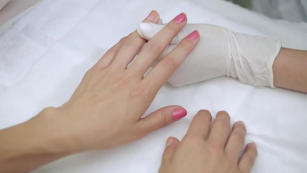 Manicure special liquid removes old red nail polish client.