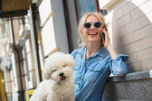 Photo Cute blonde with Bichon Frise white dog