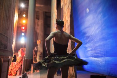 Prima ballerina standing backstage