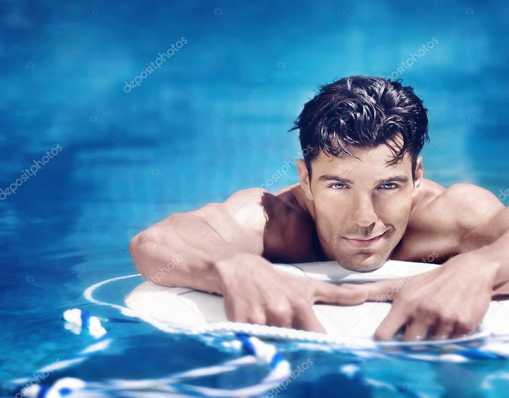 depositphotos_99056794-stock-photo-handsome-man-in-pool.jpg