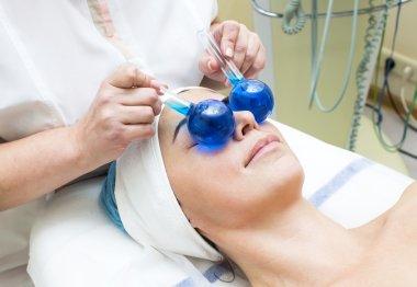 Woman on face massage procedure