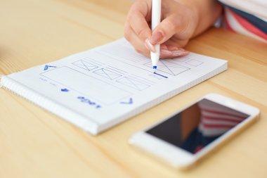 Woman sketching web design