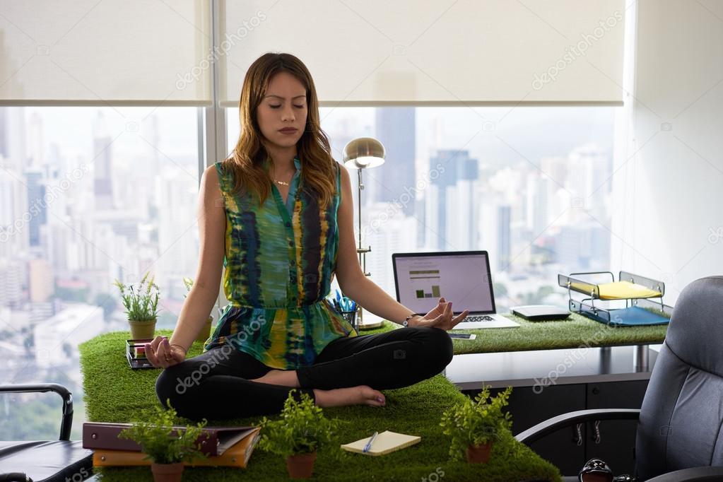 meditation office. business woman doing yoga meditation on table in office-2 \u2014 stock photo office