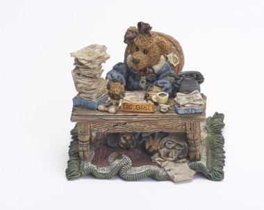 ceramic bear working at desk