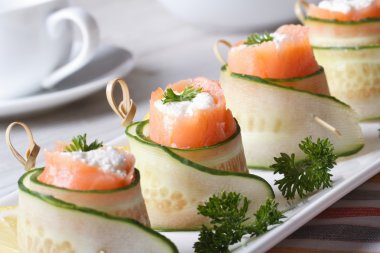 salmon rolls with cucumber, cream cheese and herbs