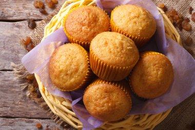 Orange muffins and raisins close-up. horizontal top view