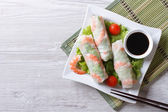 Fotografie spring roll with shrimp and vegetables, top view