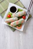 spring roll with shrimp and sauce top view vertical