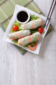Fotografie spring roll with shrimp and sauce top view vertical