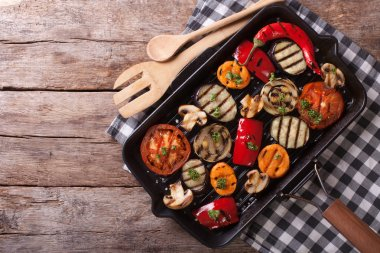 grilled vegetables in a pan grill. horizontal top view