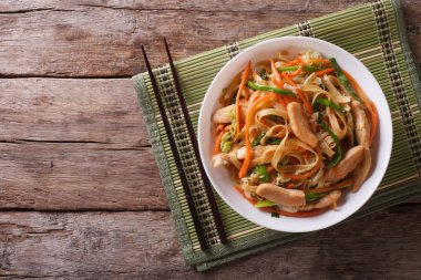 Chow Mein: fried noodles with chicken, horizontal top view