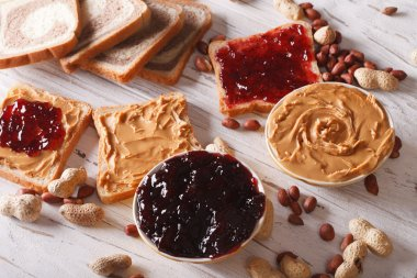 Toast with peanut butter and jelly close-up. horizontal