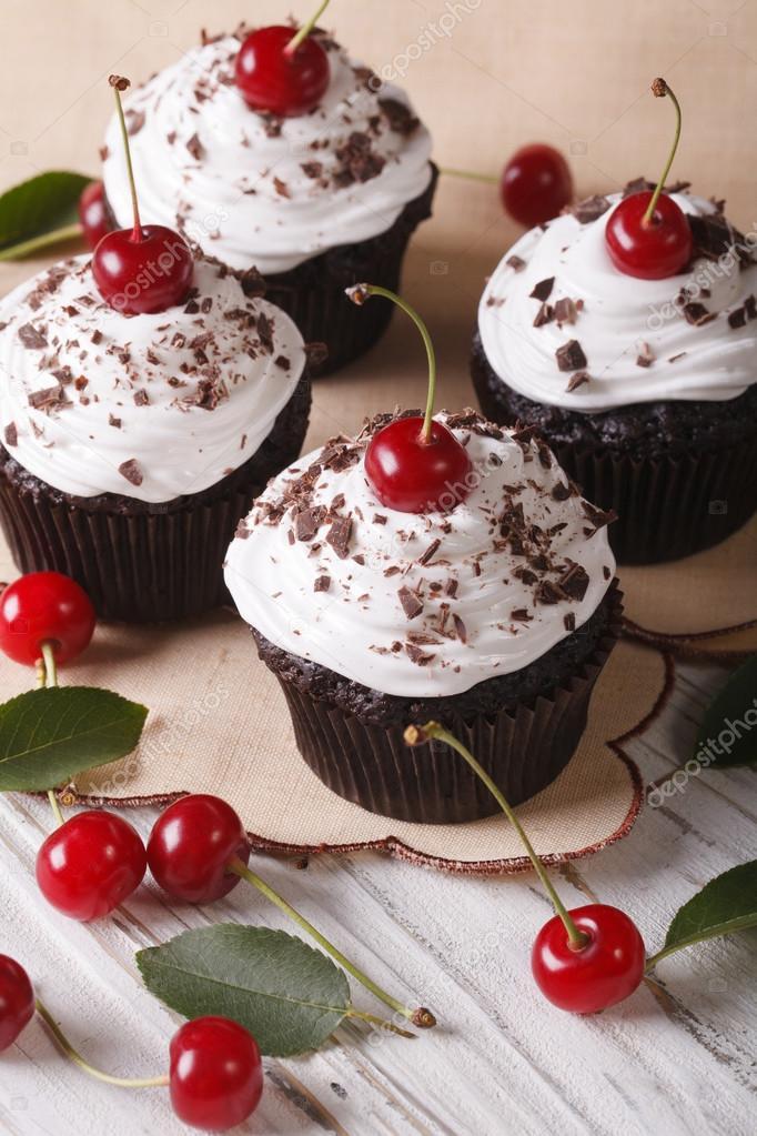 Beautiful Chocolate Cupcakes With White Cream And Cherry Vertic