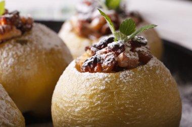 Baked apple stuffed with raisins, nuts and honey macro. Horizont