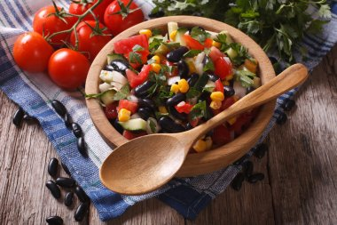 vegetable salad with black beans and ingredients table. Horizont