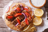 Greek souvlaki with pita close-up. horizontal view from above