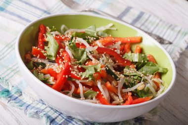 Healthy salad with sprouts, peppers and sesame closeup. horizont