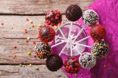 Fotografie Delicious colorful cake pops in a glass. Horizontal top view