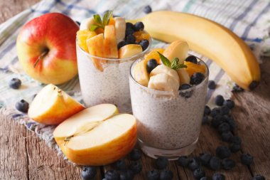 Healthy breakfast: fruit, yogurt, and chia seeds in a glass. hor