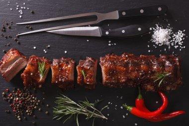 BBQ pork ribs chopped close-up on a table. Horizontal top view