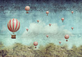 Fotografie Hot air ballons flying over a forest