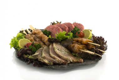 bbq dish with meat and salad