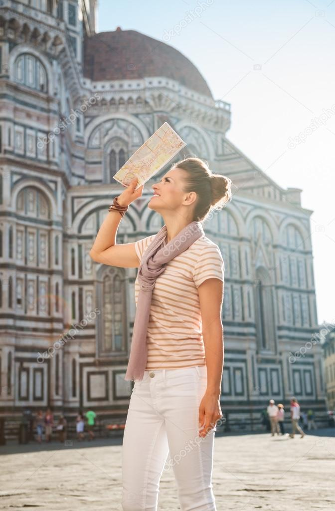 Happy Woman Tourist With Map Sightseeing In Florence Italy