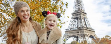 tourists mother and daughter in Minnie Mouse Ears in Paris