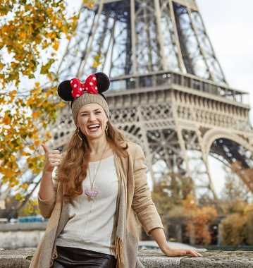 happy woman wearing Minnie Mouse Ears showing thumbs up, Paris